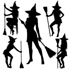 Silhouettes of Halloween witch standing with broomstick.