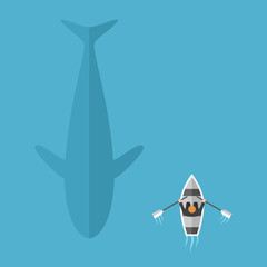 Whale swimming near boat