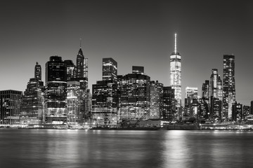 Black & White East River view of Financial District skyscrapers at dusk. Lower Manhattan skyline, New York City