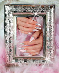 nails pink and pearl with diamonds with ancient finely decorated