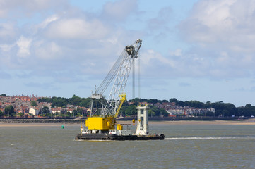 Floating crane moving in the waterways of Liverpool