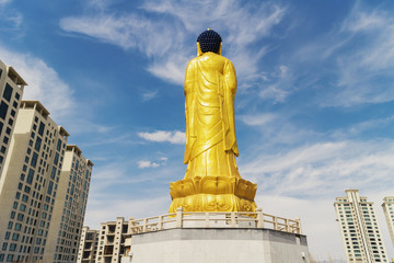 Golden statue of young Buddha near the hill Zaisan in Ulaanbator