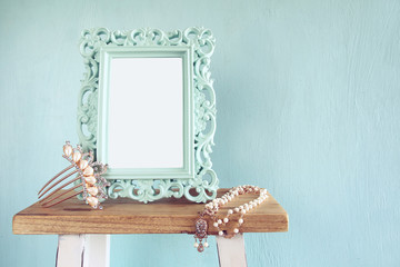 Blank victorian style frame, pearls necklace and hair decoration
