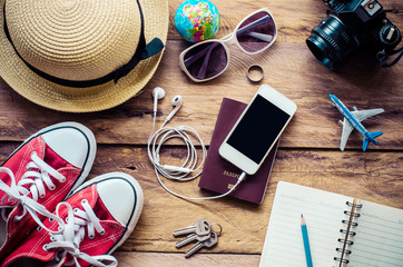 Tourism planning and equipment needed for the trip on wooden floor