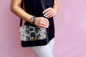 Wall Mural - woman with black snakeskin leather handbag and bracelet