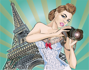 Pin-up sexy woman takes pictures on camera near Eiffel Tower in Paris