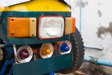 Headlight of old Tuk Tuk Thailand Car Scooter.