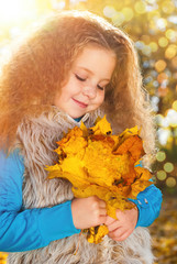 Beautiful Girl with Red Curly Hair in the Autumn Park - Sunny Day - Autumn Fall