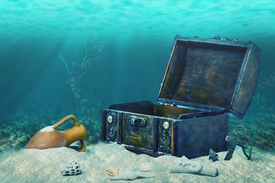 beautiful collage of closed old wooden treasure chest submerged
