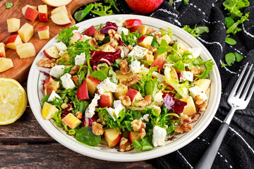 Light Fresh Home made fruit apple salad with walnuts, vegetables, feta cheese