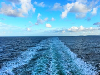 Wake after cruise ship in light waves