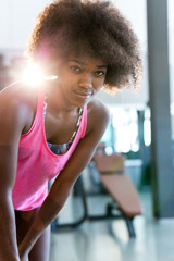 portrait of attractive afro woman enjoying time at aerobic class