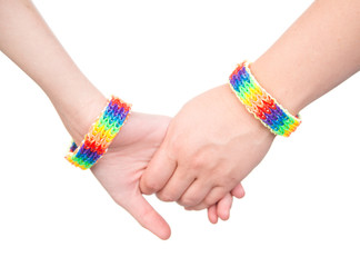 Closeup hands with a bracelet patterned as the rainbow flag. iso