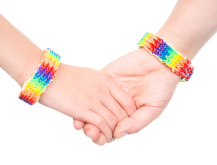 Young woman's hands with a bracelet patterned as the rainbow fla