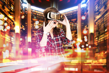 Double exposure, young girl getting experience VR headset, is using augmented reality glasses, being in virtual actuality. In the library