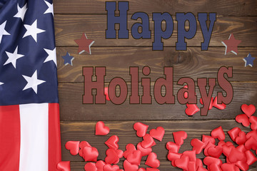 Happy holiday.American flag,many hearts and text on wooden background. The view from the top, a place for advertising.