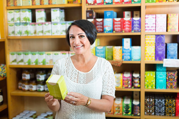 Woman having health supplements in box in drugstore