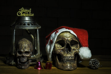 Still life with skull and present, santa is coming to town, dark