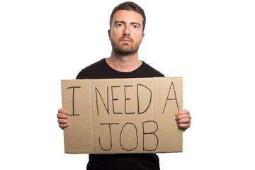 Unemployed man holding a cardboard isolated on white background