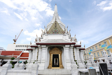 The City Pillar Shrine of Bangkok on the background blue sky.