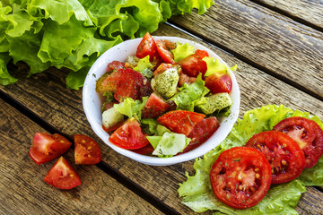 salad of cucumber and tomato with dill