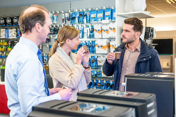 Couple Tasting Coffee Before Buying Espresso Maker