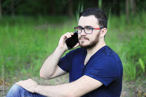 Sitting Man Is Talking On The Phone Hi Is Wearing Denim Pants Blue