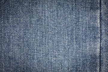 Denim jeans texture or denim jeans background with seam. Old grunge vintage denim jeans. Stitched texture denim jeans background of fashion jeans design.