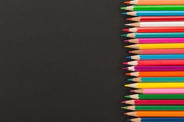 Color pencils on dark background