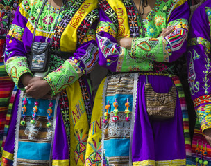 Peruvian dancers at the parade in Cusco. People in traditional clothes.