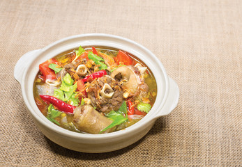 Oxtail soup in white dish on brown tablecloth/ Halal food
