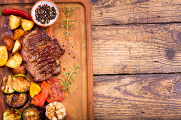 grilled meat with rosemary and vegetables