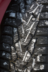 A numbers telling how much the winter tyres have wear left. The snowflake symbol tells that it is a winter tyre.