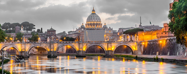 Poster Rome Rome and Vatican, cityscape at night, with St peter's basilica and bridge over the river Tiber
