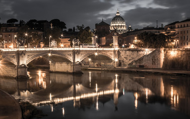 Rome and Vatican, cityscape at night, with St peter's basilica and bridge over the river Tiber