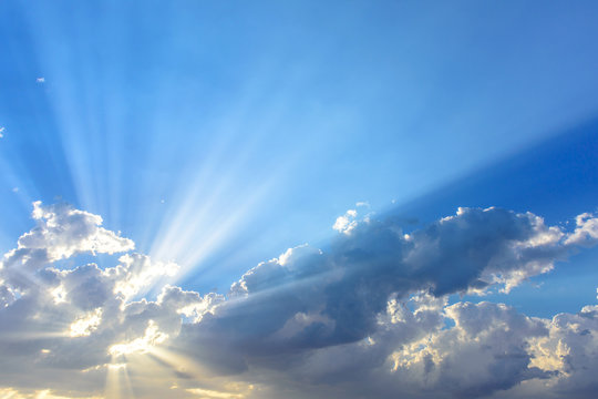 Sun beams or light rays breaking through the clouds. Beautiful s