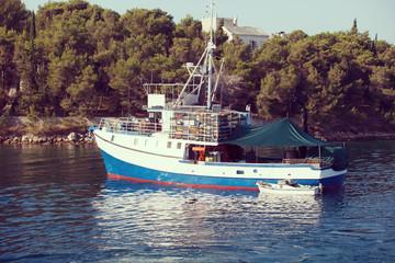 Fishing boat in marine on sea water  vintage image