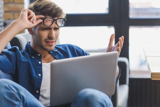 sad freelancer staring into laptop