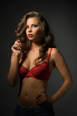 Portrait of beautiful young model dressed in bra