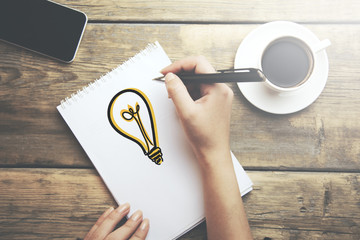 Woman painting bulb