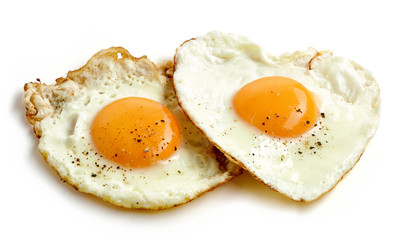fried eggs on white background