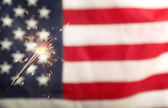 Sparkler on USA flag background
