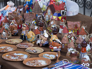 Colorful house-shaped ceramic hanging bells in the handicraft