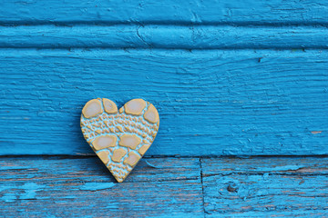 toy heart and wood background