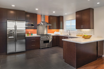 Beautiful Kitchen Interior in Dark brown with steel appliances a