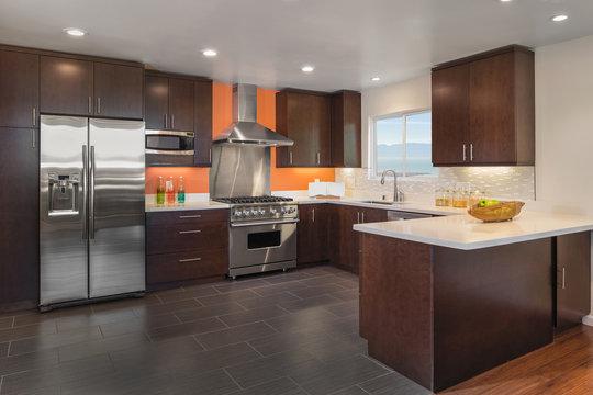 Beautiful Kitchen Interior in Dark brown with steel appliances a