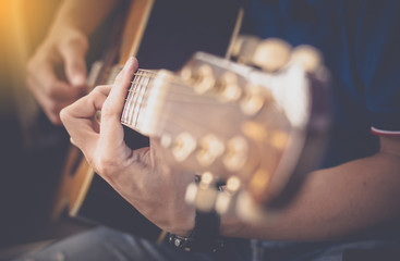 Selective focus hand of man in classical guitar,filter color effect,
