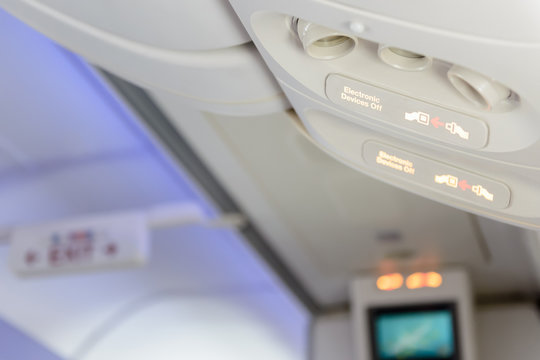 Electronic devices off and fasten seat belt sign inside airplane
