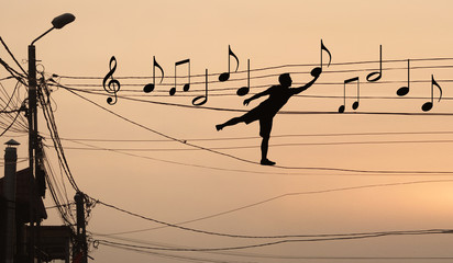 Man sits musical notes