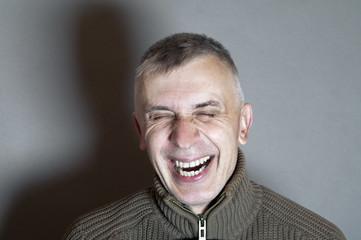 Man Bursting Into Laugh